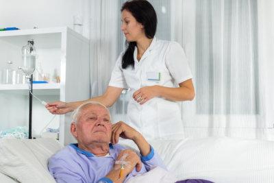senior man receives iv therapy